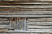 Close up view of a historic wooden hut with shutter, Särna, Dalarna Province, Sweden