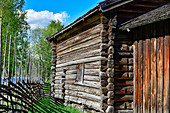 Ancient wooden hut with typical Swedish picket fence in the museum village in Särna, Dalarna province, Sweden