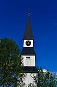 An old, white wooden church against a deep blue sky, Särna, Dalarna, Sweden