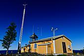 Lighthouse and weather station against a deep blue sky, Bjuröklubb, Västerbottens Län, Sweden