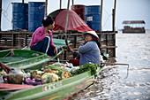 Cambodia, Siem Raep, Angkor, Tonle Sap Lake, Floating village, Vegetable saleswoman