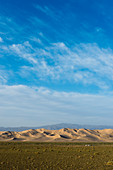 A herder ger camp in front of the Hongoryn Els sand dunes in the Gobi Desert in southern Mongolia.