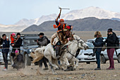 The Kyz Kuar (Catch up with a girl) game show is a traditional horseback riding game for couples were the boys being whipped by girls if the girl can catch the boy; at the Golden Eagle Festival near the city of Ulgii (Ölgii) in the Bayan-Ulgii Province in western Mongolia.