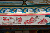 Painted roof eave showing Buddhist hell on the outside of the Ariyabal Meditation temple in Gorkhi Terelj National Park which is 60 km from Ulaanbaatar, Mongolia.