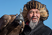Portrait of a Kazakh eagle hunter at the Golden Eagle Festival near the city of Ulgii (Ölgii) in the Bayan-Ulgii Province in western Mongolia.