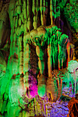 Reed Flute Caves - lit by coloured lights\nGuilin Region\nGuangxi, China\nLA008174\n