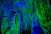 Reed Flute Caves - lit by coloured lights\nGuilin Region\nGuangxi, China\nLA008160\n