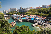 The old harbour with some seafood restaurants and the seafront promenade, Biarritz, France