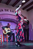 Maria José León flamenco dancing, Manuel Torres playing flamenco guitar and José León 'El Ecijano' (the singer) performing at the House of the Guitar (Casa de la Guitarra) Seville, Spain on 26 March 2016