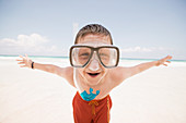 Young boy wearing a snorkel at the beach