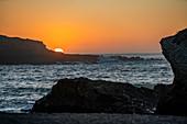 USA, California, San Luis Obispo, Sunset over sea cliff