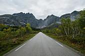 Norway, Lofoten Islands, Empty road in mountain landscape