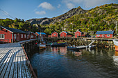 Norway, Lofoten Islands, Nusfjord, Dock in traditional fishing village