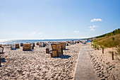 View of the beach in Karlshagen with chest baskets in the morning, Usedom, Mecklenburg-Western Pomerania, Germany