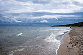 Dramatic beach panorama Baltic Sea on Usdeom cloudy sky, waves vacationers, Usedom, Mecklenburg-Western Pomerania, Germany