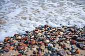 Baltic beach with stones and spray, Usedom, Mecklenburg-Western Pomerania, Germany