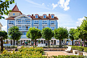 Villa on the beach promenade in Zinnowtz with green space and tourists on the promenade, Usedom, Mecklenburg-Western Pomerania, Germany