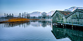 Boat houses in the evening near Schlehdorf, Kochelsee, Bavaria, Germany