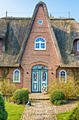 Entrance to thatched-roof villa with Easter decorations in Keitum, Sylt, Schleswig-Holstein, Germany