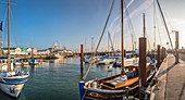 Fishing cutter in the Lister harbor at sunrise, Sylt, Schleswig-Holstein, Germany