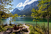 Woman on bench at Hintersee, Ramsau, Berchtesgadener Land, Upper Bavaria, Germany