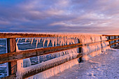 Dahme pier with icicles in the morning light, Baltic Sea, winter, Schleswig-Holstein, Germany