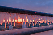 Dahme pier at sunrise with icicles, Baltic Sea, winter, morning light, Schleswig-Holstein, Germany
