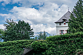 Ambras Castle with a view of the Nordkette in Innsbruck, Tyrol, Austria