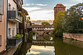 View from Flea Market Bridge to the Pegnitz (river) and the Henker's Bridge in the evening light, Nuremberg city center, Franconia, Bavaria, Germany