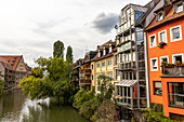 View from Karlsbrücke to Pegnitz and houses on the river in the afternoon, Nuremberg city center, Franconia, Bavaria, Germany