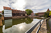 View from Maxbrücke to the Pegnitz (river) with historic house facades in the afternoon, Nuremberg city center, Franconia, Bavaria, Germany
