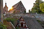 Sunset over entrance to Cadolzburg Castle on Burggraben, Cadolzburg, Franconia, Bavaria, Germany