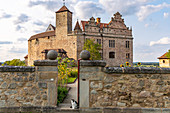 Entrance to the castle garden with a view of Cadolzburg Castle in the late afternoon, Cadolzburg, Franconia, Bavaria, Germany