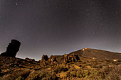 "Night shot at the ""Roques de Garcia"" in Teide National Park with a view of volcanic peaks, Tenerife, Spain"