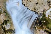 Water flows over rock slab, Pöllatschlucht, Schwangau, Upper Bavaria, Bavaria, Germany