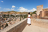 A tourist admires Albaicín neighborhood from a terrace of Alhambra, Granada, province of Granada, Andalusia, Spain