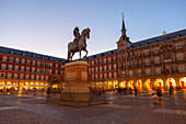 Plaza Major with Philip III statue in the evening, Madrid, Spain