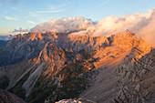 Sunset on Marmolada group seen from the summit of Cima di Costabella, Costabella Ridge, Marmolada group, Dolomites, Moena, Fassa Valley, Trento province, Trentino-Alto Adige, Italy.