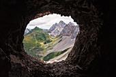 Rauchkofel, Coglians and Lastrons del Lago mountains with Volaia Lake, seen from a war cave on the ridge of Volaia Mount. Carnic Alps, Volaia Mounts group, Forni Avoltri, Udine province, Friuli Venezia Giulia, Italy.