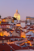 Overview at dusk of the roofs of Alfama Neighborhood with Igreja de Santa Engràcia on the background from Miraduro de Santa Luzia (St Lucy viewpoint), Alfama Neighborhood, Lisbon, Lisbon Metropolitan Area, Portugal