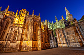 The Gothic forms of Batalha Monastery illuminated in the evening, Batalha municipality, Leiria district, Estremadura province, Portugal.