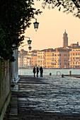 People talking in San Giorgio Maggiore island, Venice, Veneto, Italy, Europe