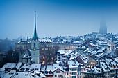 Foggy winter dusk at Bern, Canton of Bern, Switzerland, Europe.