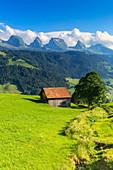 Old hut with Churfirsten mountain in the background. Alt Sankt Johann,Toggemburg,Canton of San Gallo, Switzerland, Europe