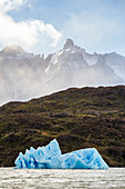 Chile, Patagonia, Magallanes and the Chilean region of Antarctica, Ultima Esperanza province, Torres del Paine National Park, iceberg float on Lake Grey