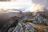 Italy,Veneto,Belluno district,Cortina d'Ampezzo,rays of setting sun illuminate the clouds over Lagazuoi