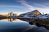 Italy,Veneto,Belluno district,Selva di Cadore,hiker arrived at lake baste to admire mount pelmo