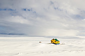 Iceland,western Iceland,Snaefellsness peninsula,a solitary and colorful house in a field of snow