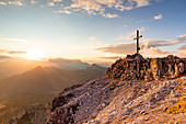 Italy,Veneto,Belluno district,the setting sun lights up the summit cross of Mount Averau