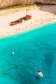 Tourists on Shipwreck beach, Zakynthos, Ionian Islands, Greece, Europe